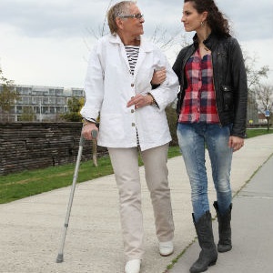 Elderly Lady Walking With A Young Woman