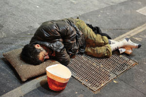 Homeless Man Sleeping On The Street